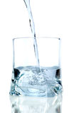 Puring water on a glass Stock Images
