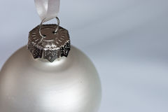 Purity. Silver christmas bauble on a silver/white background Royalty Free Stock Photography