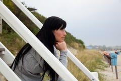 Purity. Woman relaxing on baltic-sea coastline Stock Photos
