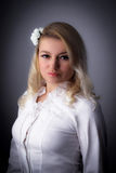 Purity. Blond woman with long hair in white shirt Royalty Free Stock Images