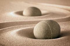 Purity and spirituality in zen garden. Purity and spirituality in the harmony of a zen garden stones and lines in sand for concentration and relaxation pure Royalty Free Stock Photo