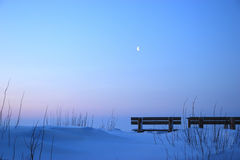 Purity winter with bench in moonlight. Photo of purity snowy dunes during winter on sea coast in moonlight Royalty Free Stock Photography