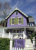 Purper huis Stock Foto's