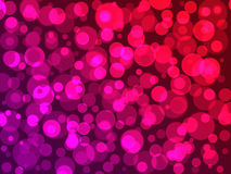 Purpere achtergrond met roze en rode ballen met bokeheffect royalty-vrije stock afbeeldingen