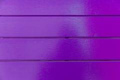 Purpere kleuren houten achtergrond stock afbeeldingen