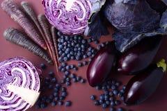 Purpere vruchten en groenten stock foto's
