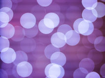 Purple abstract background with bokeh defocused lights Royalty Free Stock Photos