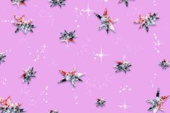 Purple abstract festive background with a pattern of stars, covered with natural snow, Royalty Free Stock Photography