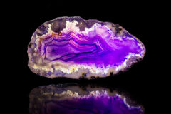 Purple agate slice, black background, healing stone and mineral Stock Photography