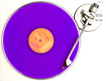 The purple album. Purple vinyl album turning on turntable stock image