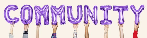Purple alphabet balloons forming the word community stock photos