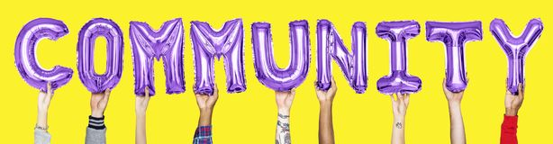 Purple alphabet balloons forming the word community stock image