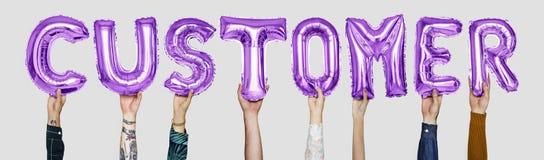 Purple alphabet balloons forming the word customer royalty free stock photos