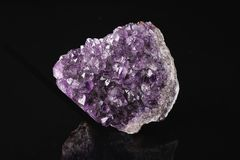 Purple amethyst on a black background. Purple amethyst on black background Stock Photography