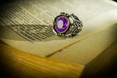 Purple amethyst cushion cut diamond fashion jewelry engagement ring. Stock Photos