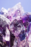 Purple amethyst stone over abstract background. For your design Royalty Free Stock Photography