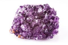Purple amethyst on a white background. Purple amethyst on white background Royalty Free Stock Photos