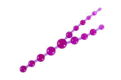 Purple anal beads - sex toy for triple penetration. Made of rubber or latex isolated on white Stock Photo