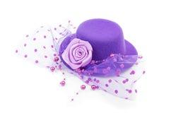 Purple antique ladies hat isolated. Purple antique ladies hat with flower isolated on white background stock photo