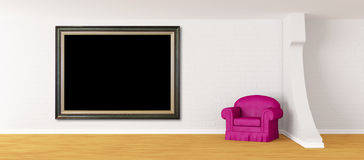 Purple armchair with picture frame Royalty Free Stock Photography