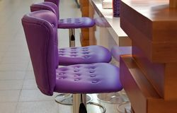 Purple armchairs for the rack stock image