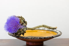 Purple artichoke flower on Moroccan dish Royalty Free Stock Photography