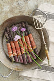 Purple asparagus with gammon Royalty Free Stock Images