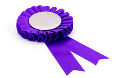 Purple award ribbons badge. With white background Royalty Free Stock Photos