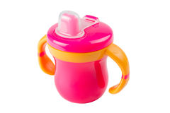 Purple baby bottle, cup with handles, isolated. Purple baby bottle, plastic children cup with handles, isolated Royalty Free Stock Photo