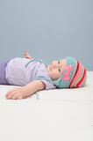 Purple baby girl smiles Stock Images