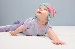 Purple baby girls cheeks Stock Photos