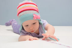 Purple baby girls first catch Royalty Free Stock Photography