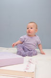 Purple baby girls first sitting Stock Image