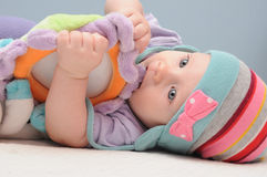 Cute baby girl with a rattle Stock Image