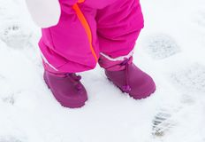 Baby snowboots in the fresh snow Royalty Free Stock Photo