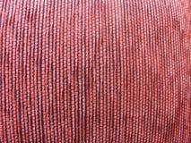 Purple background. Purple velvet background, closeup of a cushion Royalty Free Stock Photo