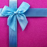 purple background with blue ribbon, blue bow, Christmas background, Christmas gifts Royalty Free Stock Images