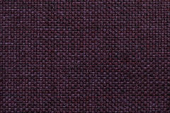 Purple background with braided checkered pattern, closeup. Texture of the weaving fabric, macro. Stock Photo