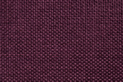Purple background with braided checkered pattern, closeup. Texture of the weaving fabric, macro. Royalty Free Stock Photo