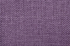 Purple background with braided checkered pattern, closeup. Texture of the weaving fabric, macro. Light violet background with braided checkered pattern, closeup Stock Image