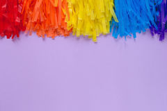 Purple background with colored garland Stock Photography