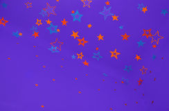 Purple background with colorful stars. Purple background with yellow,orange and blue shiny stars royalty free illustration