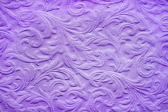 Purple background in the form of an ancient baroque repeating design stock images