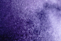 Purple Background formed by water droplets, a beautiful pattern. Royalty Free Stock Image