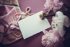 Purple background with peony flowers Stock Photo