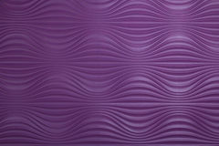 Purple background. Background of a rippled purple wall, close-up Stock Photo