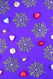 Purple background with snowflakes and candies Stock Photo