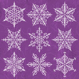 Purple  background with snowflakes, vector Stock Photos
