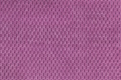 Purple background from soft fleecy fabric closeup. Texture of textile macro Royalty Free Stock Photography