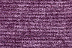 Purple background from soft textile material. Fabric with natural texture. Royalty Free Stock Photography